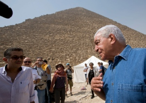 Egyptian archaeologist Zahi Hawass, Egypt's former head of antiquities, speaks in front of the Great pyramid, built by Cheops, known locally as Khufu in Giza, Egypt, Thursday, June 2, 2016.  (AP Photo/Amr Nabil)