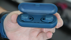 Samsung's Gear IconX earbuds come with in-ear sensors for tracking heart rate, distance and pace during workouts. (AP Photo/Anick Jesdanun)
