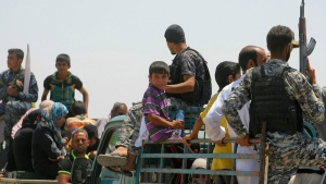 Families from Fallujah flee their homes during fighting between Iraqi security forces and Islamic State group during a military operation to regain control the city, 65 kilometres west of Baghdad, Iraq on Wednesday, June 1, 2016. (AP / Anmar Khalil)
