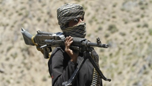 A member of a breakaway faction of the Taliban fighters guards a gathering in Shindand district of Herat province, Afghanistan on Friday, May 27, 2016. (AP / Allauddin Khan)