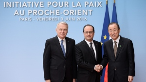 French Foreign minister Jean-Marc Ayrault, left, French President Francois Hollande and United Nations Secretary General Ban Ki-moon, right, pose for photographers prior to an international meeting in a bid to revive the Israeli-Palestinian peace process in Paris, France, Friday, June 2, 2016. (Stephane de Sakutin/Pool Photo via AP)