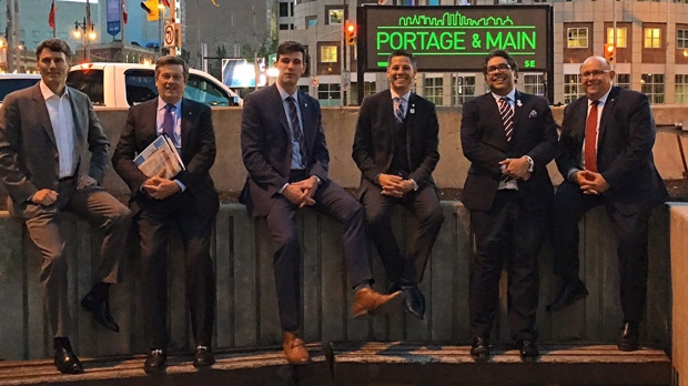 Mayor Brian Bowman (third from right) said Calgary Mayor Naheed Nenshi (second from right) got lost in the underground walkway while trying to cross Portage and Main. (Source: Twitter/@Mayor_Bowman)
