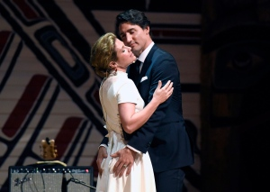 Prime Minister Justin Trudeau and his wife Sophie Gregoire Trudeau joke on stage during the annual Press Gallery Dinner at the Museum of History in Gatineau, Quebec on Saturday, June 4, 2016. (Justin Tang / THE CANADIAN PRESS)