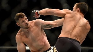 Michael Bisping, left, fights Luke Rockhold during a UFC 199 at the Forum in Inglewood, Calif., Saturday June 4, 2016. (Hans Gutknecht/Los Angeles Daily News via AP)