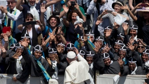 Pope Francis blesses devotees of Elizabeth Hesselblad as he tours St. Peter's Square at the Vatican after the canonization ceremony Sunday, June 5, 2016. (AP / Alessandra Tarantino)