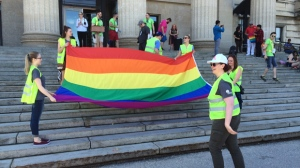 The Pride Flag is unfurled on the steps of the Legislative Building during a rally ahead of the Pride Parade through downtown Winnipeg on Sunday, June 5, 2016.