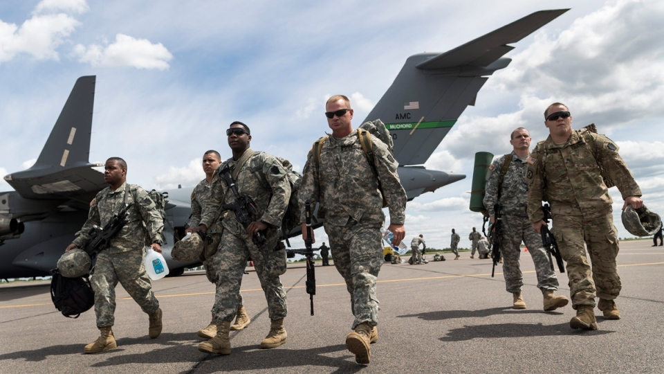 Members of the U.S. Army of the Pennsylvania National Guard arrive by plane in Vilnius, Lithuania, on June 5, 2016. (Mindaugas Kulbis / AP)