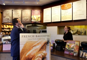 In this March 8, 2010 file photo, a customer reviews the sandwich board at the Panera store in Brookline, Mass. (AP / Charles Krupa, File)