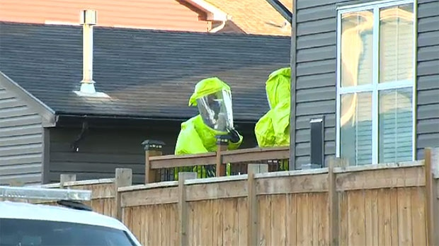 CLEAR Team members work to decontaminate a home on Autumn Terrace that is believed to be a fentanyl re-processing lab.