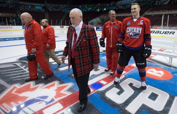 Team Cherry coach Don Cherry, centre, assistant Brian Sutter, back right, and Jakob Chychrun, right, who plays for the OHL's Sarnia Sting, leave the ice after a team photo before the CHL/NHL Top Prospects Game in Vancouver, B.C., on Thursday January 28, 2016. (Darryl Dyck / THE CANADIAN PRESS)