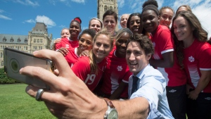 Prime Minister Justin Trudeau takes a photo with members of the Canadian Women's national soccer team on Parliament Hill in Ottawa Monday June 6, 2016. (THE CANADIAN PRESS/Adrian Wyld)