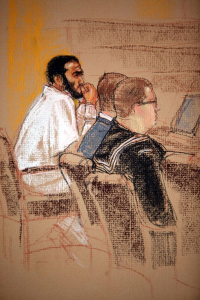 In this courtroom sketch Omar Khadr, far left, sits with his defense team during a hearing at the U.S. Military Commissions, at the U.S. Naval Base, in Guantanamo Bay, Cuba, Tuesday, Jan. 20, 2009. (AP / Janet Hamlin)