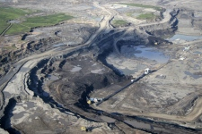 A massive open pit oil sands mine is seen just north of Fort McMurray, Alta., on June 25, 2008. (AP / Eamon MacMahon)