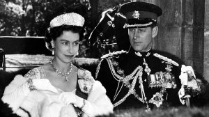 The Queen in her Coronation gown and Prince Philip in the uniform of a Colonel-in-chief of the Royal Canadian Regiment present a royal picture as they drive in an open carriage to open Canada's Parliament Oct. 14, 1957. (AP PHOTO)