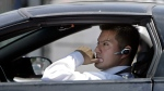 A driver, in compliance with the new California law requiring the use of hands-free mobile phone devices, wears a hands-free device while waiting at a red light Tuesday, July 1, 2008, in Los Angeles. (AP Photo/Ric Francis)