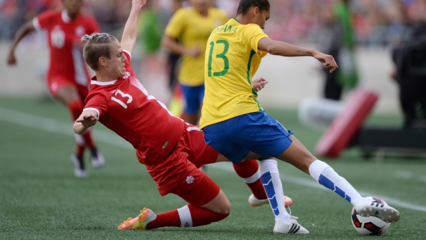 Canada's Sophie Schmidt, left, defends against Brazil's Poliana during first half international women's friendly soccer action in Ottawa on Tuesday, June 7, 2016. (Sean Kilpatrick / THE CANADIAN PRESS)