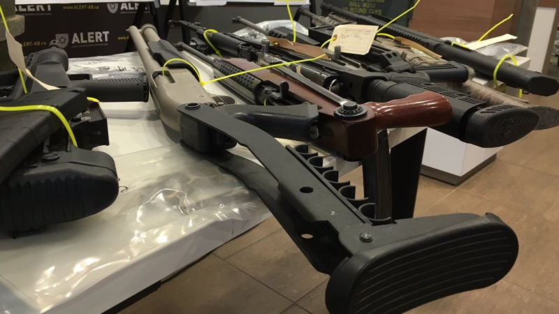 ALERT display some of the 21 firearms seized as part of Project Al-Wheels in May, 2016.