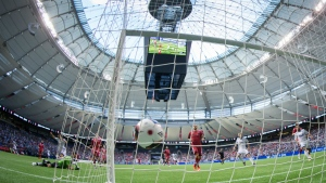 Ottawa Fury goalkeeper Romuald Peiser, bottom left, looks back as the ball bounces in the back of the net after Vancouver Whitecaps' Octavio Rivero scored the team's third goal during second half semifinal Canadian Championship soccer action in Vancouver, B.C., on Wednesday June 8, 2016. (Darryl Dyck / THE CANADIAN PRESS)