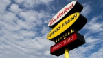 The sign of a Tim Hortons is pictured in downtown Kingston, Ont., on Nov. 18, 2015. (Lars Hagberg / THE CANADIAN PRESS IMAGES)
