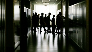 In this Aug. 29, 2013 file photo, students walk through the halls during an open house for incoming students at a high school in Philadelphia. (The Associated Press, file)