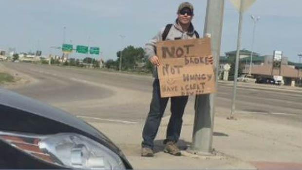 A police officer posing as a panhandler is seen in this photo taken in Regina. (FACEBOOK)