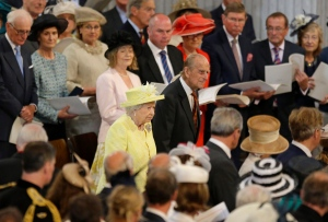 Queen Elizabeth II and Prince Philip arrive for a National Service of Thanksgiving to mark her 90th birthday at St Paul's Cathedral in London, Friday, June 10, 2016. Queen Elizabeth II is celebrating her official 90th birthday with a three-day series of festivities starting Friday, on what is also her husband Prince Philip's 95th birthday. (AP / Matt Dunham)