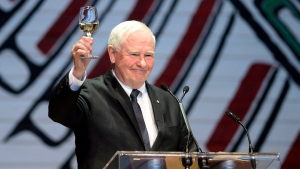 In this file photo, Governor General David Johnston raises his glass in a toast to the 150th anniversary of the Parliamentary Press Gallery, at the annual Press Gallery Dinner at the Canadian Museum of History on Saturday, June 4, 2016 in Gatineau, Quebec. (Justin Tang/The Canadian Press)