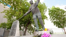Flowers have been left at a statue of Gordie Howe