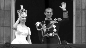 This is a June. 2, 1953 file photo of Britain's Queen Elizabeth II and Prince Philip, Duke of Edinburgh, as they wave to supporters from the balcony at Buckingham Palace, following her coronation at Westminster Abbey. London. (AP Photo / Leslie Priest, File)