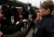 Vancouver Police Cnst. Jana McGuinness takes questions from the media after three off-duty police officers were arrested on allegations they assaulted and robbed a man in Vancouver, B.C., on Wednesday January 21, 2009. (THE CANADIAN PRESS/Darryl Dyck)