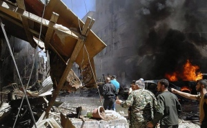 In this photo released by the Syrian official news agency SANA, Syrians gather around damaged buildings after a bomb attack at the Sayyida Zeinab suburb, Damascus, Syria, Saturday, June 11, 2016. (SANA via AP)