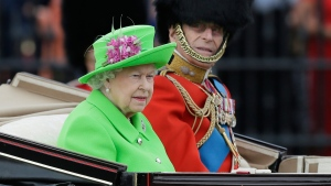 Queen Elizabeth II and Prince Philip ride in a carriage during the Trooping The Colour parade at Buckingham Palace, in London, Saturday, June 11, 2016. (Tim Ireland / AP)