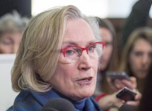 Federal Indigenous Affairs Minister Carolyn Bennett talks with reporters at a meeting of the Atlantic Policy Congress of First Nations Chiefs Secretariat in Halifax on Wednesday, in an April 27, 2016, file photo. THE CANADIAN PRESS/Andrew Vaughan