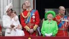 Queen Elizabeth II smiles with Prince Philip, right, Prince William, centre, his son Prince George, front, and Kate, Duchess of Cambridge holding Princess Charlotte, left, on the balcony during the Trooping The Colour parade at Buckingham Palace, in London, Saturday, June 11, 2016. (AP Photo/Tim Ireland)