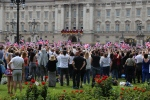 Crowds wave to Queen Elizabeth II and the Royal Family on the the balcony of Buckingham Palace on Saturday, June 11, 2016. (Rosa Hwang / CTV News)