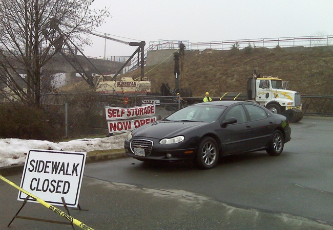 Heavy equipment which will be used to repair the Pattullo Bridge was towed to the scene of the fire that damaged the bridge on Wednesday, Jan. 21, 2009. (CTV / Julia Foy)