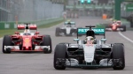 Mercedes driver Lewis Hamilton of Great Britain (44) comes out of the pits ahead of Ferrari driver Sebastian Vettel of Germany (5) during qualifying at the Canadian Grand Prix in Montreal, Saturday, June 11, 2016. THE CANADIAN PRESS/Graham Hughes