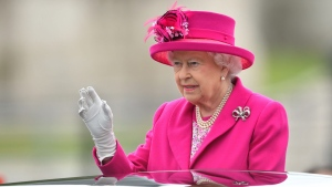 Queen Elizabeth II arrives at the Patron's Lunch in The Mall, central London in honour of the her 90th birthday, in an open topped Range Rover. Sunday June 12, 2016. The Queen's grandson Peter Phillips has masterminded the street party for 10,000 people, to mark the monarch's patronage of more than 600 charities and organisations. (Dominic Lipinski / AP)