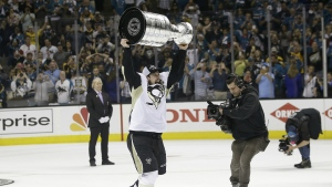 Pittsburgh Penguins centre Sidney Crosby celebrates with the Stanley Cup after Game 6 of the NHL hockey Stanley Cup Finals against the San Jose Sharks in San Jose, Calif. on Sunday, June 12, 2016. (AP / Marcio Jose Sanchez)