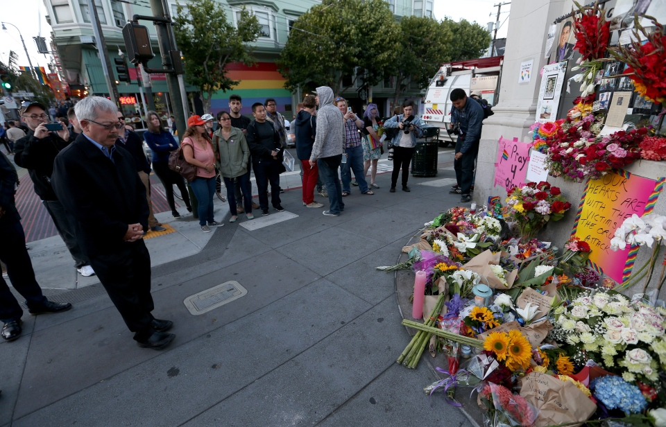 San Francisco Mayor Ed Lee pauses after placing a candle at a memorial on Castro Street and 18th Street during a vigil at Harvey Milk Plaz in the Castro district of San Francisco, Calif., on Sunday, June 12, 2016. (Jane Tyska/Oakland Tribune via AP)