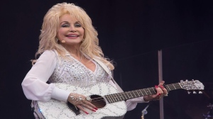 Dolly Parton performs on the main Pyramid stage at Glastonbury music festival in England in June 2014. (Joel Ryan/AP)