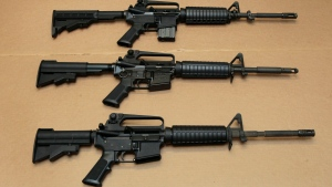 In this Aug. 15, 2012 file photo, three variations of the AR-15 assault rifle are displayed at the California Department of Justice in Sacramento, Calif.  (Rich Pedroncelli/AP Photo)