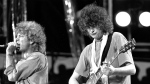 Singer Robert Plant, left, and guitarist Jimmy Page of the British rock band Led Zeppelin perform at the Live Aid concert at Philadelphia's J.F.K. Stadium on July 13, 1985. (Rusty Kennedy/AP)