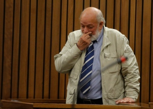 Barry Steenkamp, father of Reeva Steenkamp, gives evidence in mitigation of sentence as Oscar Pistorius appears in the High Court in Pretoria, South Africa, Tuesday, June 14, 2016 on the second day of the double-amputee runner's sentencing hearing for murdering girlfriend Steenkamp. (AP Photo/Kim Ludbrook, Pool)