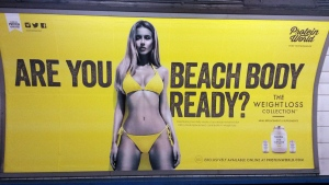 This is an April 27, 2015 file photo of a Protein World advert displayed in an underground station in London. (Catherine Wylie/Pa, File via AP)