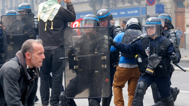 Police come under attack, fire tear gas in Paris protest