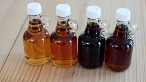Four bottles of maple syrup are shown in this file photo. (AP/Matthew Mead)