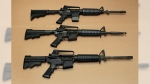In this Aug. 15, 2012 photo, three variations of the AR-15 assault rifle are displayed at the California Department of Justice in Sacramento, Calif. (AP / Rich Pedroncelli)