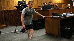 Oscar Pistorius walks on his stumps in the High Court in Pretoria, South Africa, on June 15, 2016. (Alon Skuy, Pool via AP)
