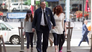 Toronto Police Supt. David (Mark) Fenton arrives at his sentencing hearing with his family at Toronto Police Headquarters in Toronto on June 15, 2016. (Chris Young / THE CANADIAN PRESS)